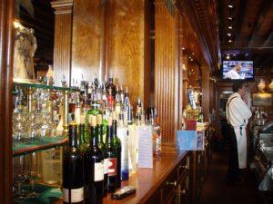 A bartender standing behind a bar