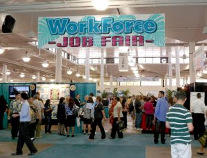 A group of people at a job fair are shown here