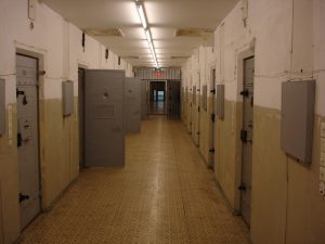 Figure (b) shows the hallway of a correctional facilty