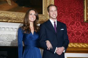 Prince William is shown holding wife Catherine Middleton's hand
