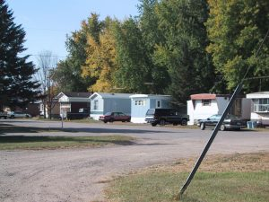 Figure (b) is a mobile home park