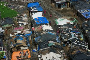Dilapidated slum dwellings are shown from above