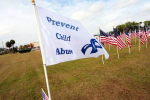 A flag with the words Prevent Child Abuse on it