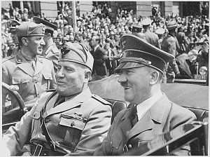 Adolf Hitler and Benito Mussolini are shown riding together in a car